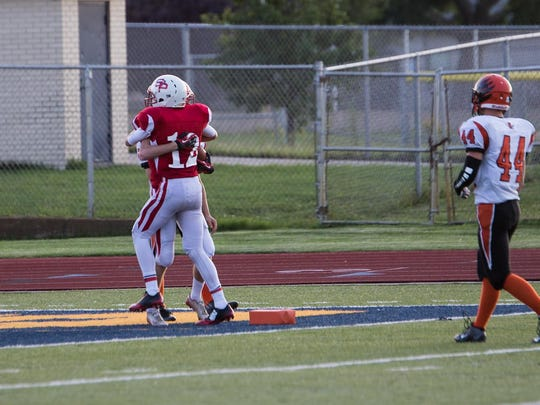 St. Phillip's Drew Lantinga (12) celebrates with David Downey after a touchdown against Morrice on Thursday night.