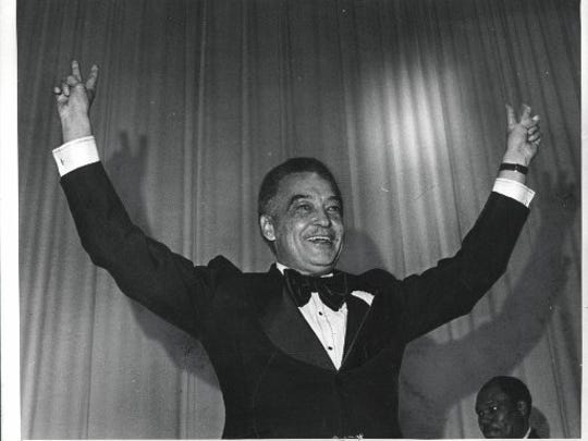 Mayor Coleman Young flashed his victory sign at his