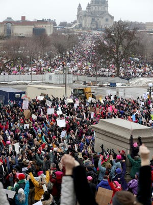 Seen from the steps of the Capitol, protestors in a huge crowd hold hands at the Women's March Minnesota Saturday, Jan. 21, 2017, in St. Paul, Minn. (David Joles /Star Tribune via AP)