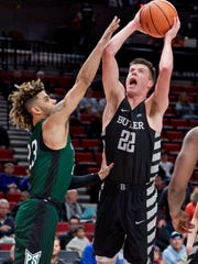 Butler guard Sean McDermott, right, shoots over Portland State guard Holland Woods during the first half of an NCAA college basketball game in the Phil Knight Invitational tournament in Portland, Ore., Friday, Nov. 24, 2017. (AP Photo/Craig Mitchelldyer)