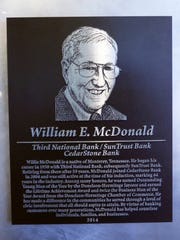A plaque hangs on the wall at CedarStone Bank honoring Willie McDonald for his years of service.