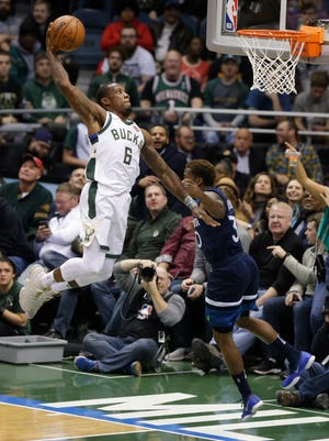 Bucks guard Eric Bledsoe soars for a dunk vs. the Timberwolves on Thursday night at the BMO Harris Bradley Center.