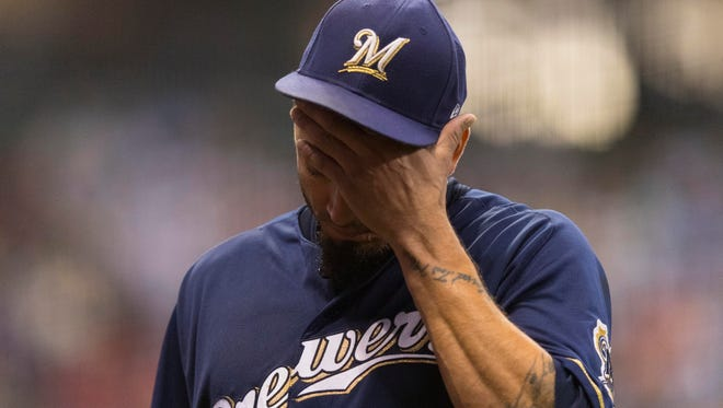 Brewers starter Matt Garza gets pulled from the game during the fourth inning against the Cardinals on Tuesday.