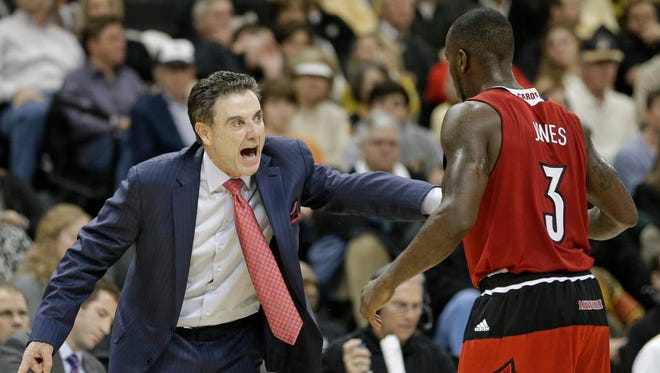 Louisville head coach Rick Pitino, left, shouts at Chris Jones, right, during the second half of an NCAA college basketball game against Wake Forest in Charlotte, N.C., Sunday, Jan. 4, 2015. Louisville won 85-76. (AP Photo/Chuck Burton)
