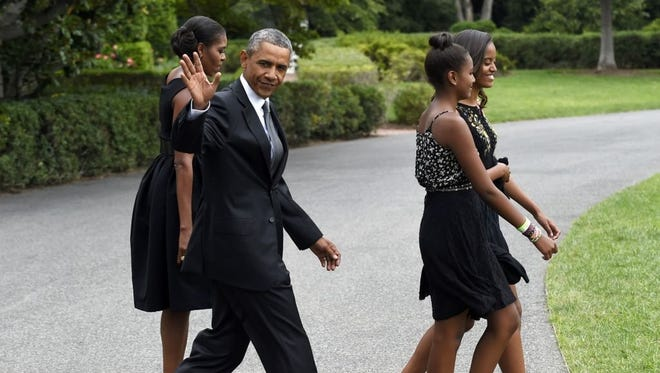 """President Barack Obama said he and first lady Michelle Obama and their daughters, Sasha and Malia, will make the trip """"to pay tribute not just as a president or a first lady or as African-Americans, but as Americans -- to those who changed the course of history at the Edmund Pettus Bridge."""""""