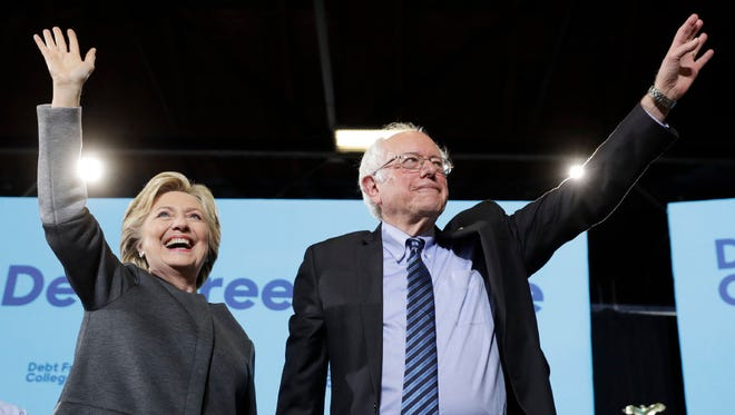 Democratic presidential candidate Hillary Clinton and Sen. Bernie Sanders, I-Vt., take the stage during a campaign stop at the University Of New Hampshire in Durham, N.H., Wednesday, Sept. 28, 2016.