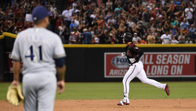 Brandon Drury circles the bases after hitting a two-out, two-run homer against Brewers starter Junior Guerra in the sixth inning to put the Diamondbacks ahead to stay on Friday night.