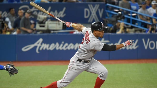 Boston Red Sox pinch hitter Xander Bogaerts (2) hits an RBI single against the Toronto Blue Jays in the 11th inning  at Rogers Centre.