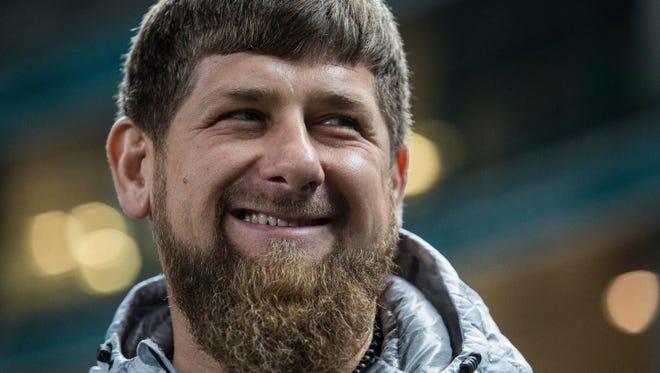 In this file photo dated Tuesday, Nov. 15, 2016, Chechen regional leader Ramzan Kadyrov smiles before an international friendly soccer match between Russia and Romania in Grozny, Russia. Chechnya's strongman leader in a new interview, released on Friday, July 14, 2017, has harshly denounced claims that the Russian republic has tortured and killed gay men, denying that there are even any homosexual men in his region.