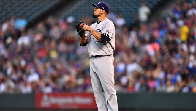 Starting pitcher Matt Garza reacts after the Brewers committed an error in the fourth inning against the Rockies on Friday night in Denver.