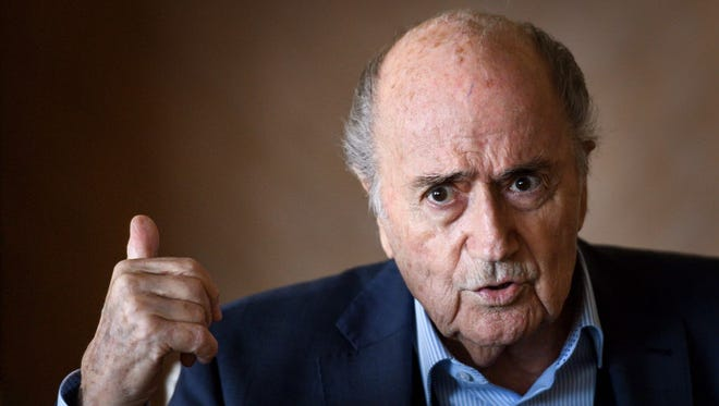 Former FIFA president Sepp Blatter gestures during a press conference in Zurich.