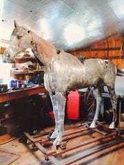 The American Girl statue as it appeared during the process of restoration.