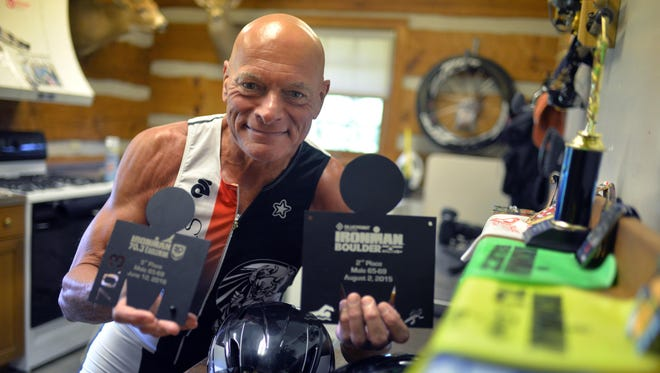 Triathlete Ken Pagliughi with recent Ironman trophies, Monday, Jul. 11, 2016 in Millville.