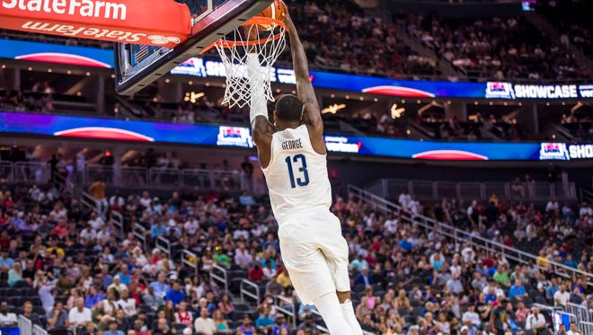 Jul 22, 2016; Las Vegas, NV, USA; USA forward Paul George (13) dunks the ball against Argentina during a basketball exhibition game at T-Mobile Arena. USA won 111-74. Mandatory Credit: Joshua Dahl-USA TODAY Sports