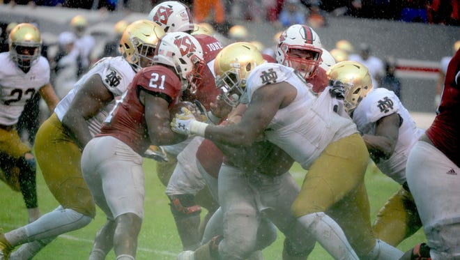Oct 8, 2016; Raleigh, NC, USA;  North Carolina State Wolfpack running back Matt Dayes (21) runs the ball during the second half against the Notre Dame Fighting Irish at Carter Finley Stadium. The Wolfpack won 10-3. Mandatory Credit: Rob Kinnan-USA TODAY Sports