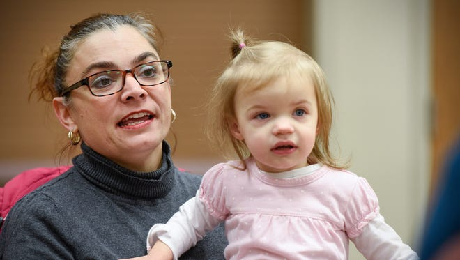 Deanna Hoeschen holds her adopted daughter Mary, 22 months, who at first was her foster child. They attended a foster care provider support group meeting Thursday, Nov. 17, at Calvary Community Church.