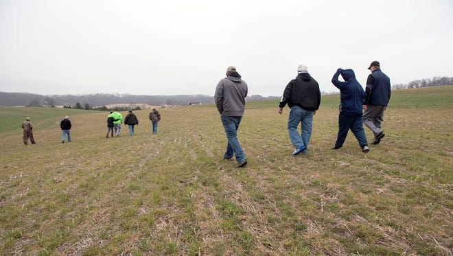 A search party heads out at the start of the effort, Sunday, March 26, 2017. Madison Nichole Krumrine, 16, has been missing since March 23.