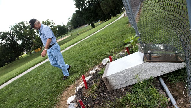 Larry Hartlaub walks past his son's memorial at the Littlestown baseball fields, Wednesday, July 26, 2017. The memorial is in honor of Benji Hartlaub, who died after a car crash on Feb. 11, 1993.