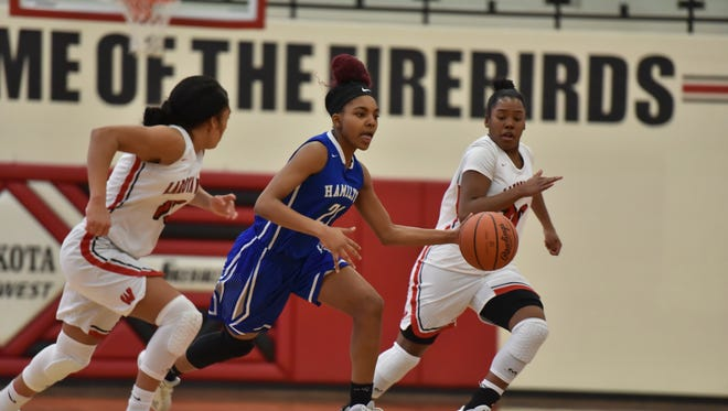 Hamilton's Cici Riggins pushes the ball up the floor for the Big Blue Wednesday, January 31st at Lakota West High School