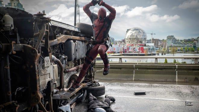 Deadpool (Ryan Reynolds) pounces on an adversary.