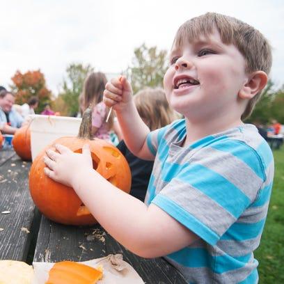 Steven Cowles, 6, shows off his pumpkin carving skills
