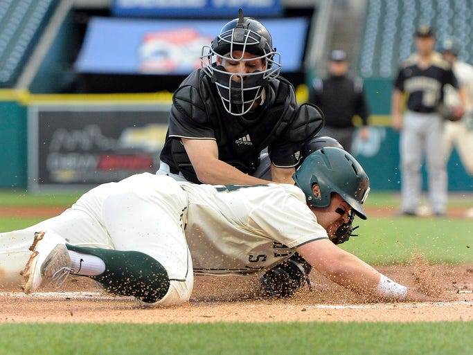 Western Michigan catcher Alex Goodwin  tags out Michigan