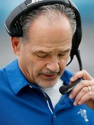 Indianapolis Colts head coach Chuck Pagano hangs his