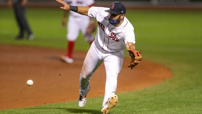 Former Red Sox second baseman Jose Peraza attempts to field a ground ball during the fourth inning in a game against the Rays at Fenway Park. Peraza and outfielder Cesar Puello opted for free agency after getting out-righted off of the 40-man roster.