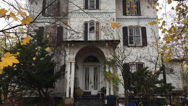A three-family Italianate-style house at 239 Palisade Ave. in Yonkers will be auctioned Dec. 8.