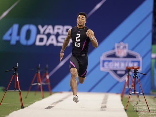 Alabama defensive back Anthony Averett runs the 40-yard dash during the NFL football scouting combine, Monday, March 5, 2018, in Indianapolis.
