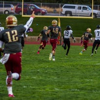 Cedar celebrates as Bodrey Allred (#15) scores the first touchdown of the game, Friday, Oct. 9, 2015.