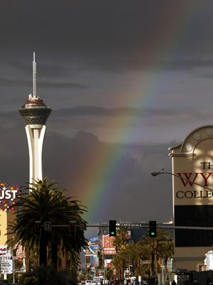 A rainbow illuminates the Las Vegas Strip by the Stratosphere Hotel and Casino, Feb. 23, 2004.