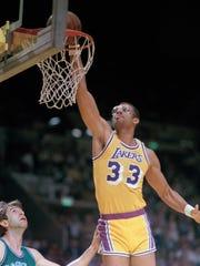 Kareem Abdul-Jabbar of the Los Angeles Lakers dunks against Dallas in 1984.