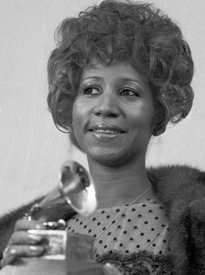 """FILE - In this March 13, 1972 file photo, Aretha Franklin holds her Grammy Award for Best Rhythm and Blue performance of the song """"Bridge Over Troubled Waters,"""" in New York. A person close to Franklin said on Monday that the 76-year-old singer is ill. Franklin canceled planned concerts earlier this year after she was ordered by her doctor to stay off the road and rest up. (AP Photo/Dave Pickoff, File)"""