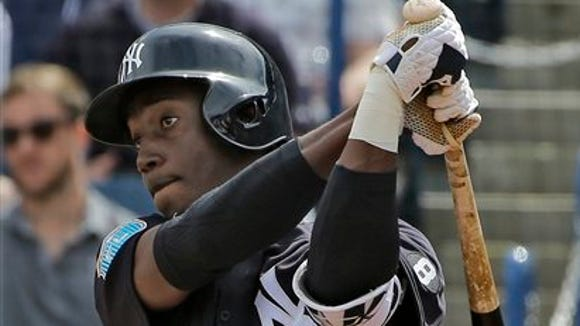 New York Yankees' Jorge Mateo follows the flight of his home run off Boston Red Sox starting pitcher Steven Wright during the third inning of a spring training baseball game Saturday, March 5, 2016, in Tampa, Fla.