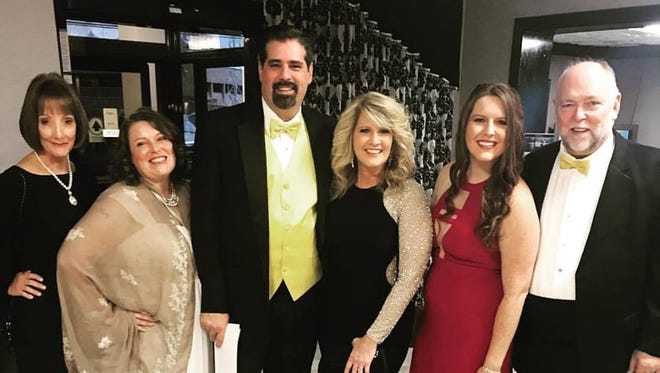 """Brent Lane, third from left, and Candy Ruddy, second from left, of """"The Cat Pak Morning Show"""" represented Cat Country 98.7 in Nashville Wednesday at the Country Music Awards."""