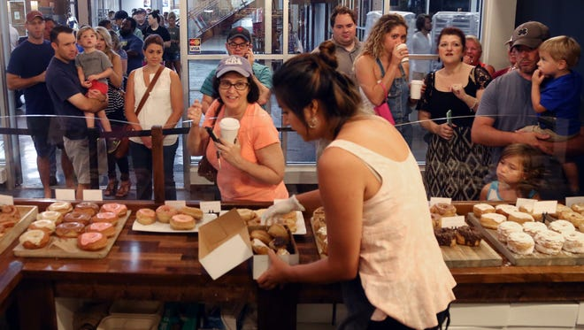 Customers make their way into Five Daughters Bakery in the Factory at Franklin to purchase freshly made doughnuts Saturday, August 20, 2016.