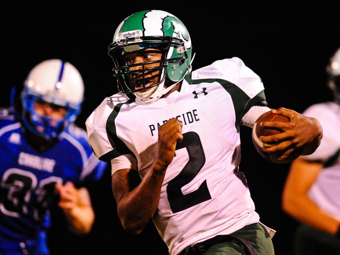 Parkside quarterback Devin Redding finds the open field against the North Caroline Bulldogs on Friday night in Ridgely.