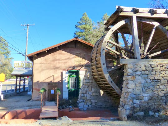 The water wheel  and old adobe structure attracts tourists,