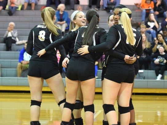 Buffalo Gap players come together after winning a point
