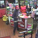 A man is seen here during a June 7 armed robbery of a Shell gas station on Hardy Street.