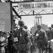 In this July 14, 1969, file photo, banners of appreciation from the Vietnamese decorate the dock at Danang, Vietnam, where a farewell ceremony was held by the Vietnamese Government for departing Marines of the 1st Battalion/9th Regiment. The Marine Corps is holding a deactivation ceremony on Friday, Aug. 29, 2014, for the 1st Battalion, 9th Marine Regiment, 2nd Marine Division, a battalion nicknamed the 'Walking Dead.'