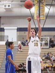 Hartland senior Miles McDonald shoots one of two freethrows that both contributed to the Eagles' score in the game against Walled Lake Western.