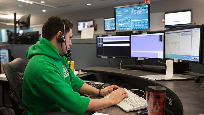 911 Telecommunicator Jesse Richerson works at the dispatch center.