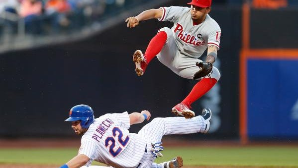 Kevin Plawecki of the Mets is forced out at second base as Freddy Galvis #13 of the Philadelphia Phillies is unable to complete the double play in the third inning at Citi Field on May 26, 2015 in Flushing neighborhood of the Queens borough of New York City.
