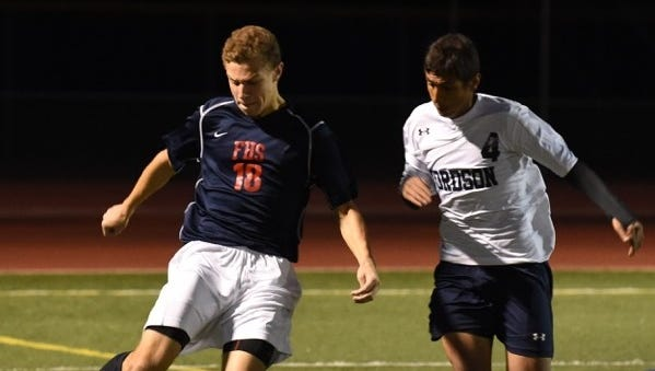 Franklin's Austin Corona advances the ball up the field during Wednesday's victory over Fordson.