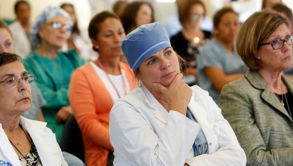 Laura Fanning, the nursing director for the operating room, attends an information session on Ebola and how to handle a case with other hospital staff and health care providers Friday at St. John's Riverside Hospital in Yonkers.