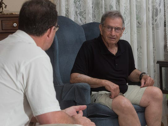 From left, David Van Der Like, director of the Northwest Florida Guardian Ad Litem Foundation, and volunteer Joe Zimmers talk Tuesday, June 5, 2018, about how to increase the number of volunteers in the program.