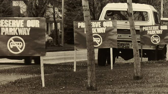 Signs protesting the Fort Collins streetcar project line Mountain Avenue in this undated photograph.