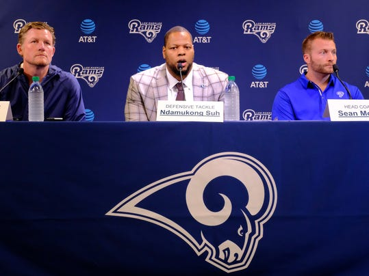 Los Angeles Rams new defensive tackle Ndamukong Suh, center, talks during a news conference with head coach Sean McVay, right, and general manager Les Snead, left, at the team's practice facility in Thousand Oaks, Calif., Friday, April 6, 2018. (AP Photo/Richard Vogel)